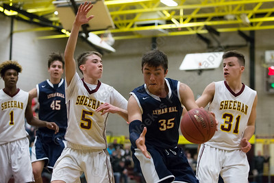 Lyman Hall's Pat Doherty looks for room down low Saturday at Sheehan High School in Wallingford January 6, 2018 | Justin Weekes / Special to the Record-Journal