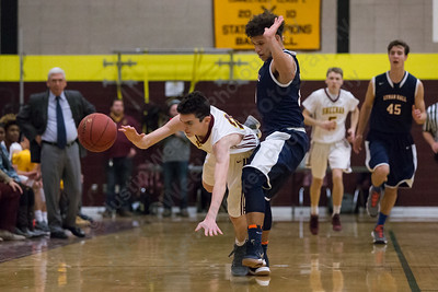 Sheehan's Tyler Carmen gets fouled by Lyman Hall's Shakespeare Rodriguez Saturday at Sheehan High School in Wallingford January 6, 2018 | Justin Weekes / Special to the Record-Journal