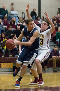 Lyman Hall's Jake Ranney drives baseline on Sheehan's Jack McDonnell  Saturday at Sheehan High School in Wallingford January 6, 2018 | Justin Weekes / Special to the Record-Journal