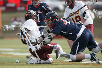 Lyman Hall's Cade Sullivan knock the ball loose from Sheehan's Adam Shoshani Monday at Sheehan High School in Wallingford April 9, 2018 | Justin Weekes / Special to the Record-Journal