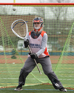 Lyman Hall's Ryan Niemiec warms up in goal Wednesday at Lyman Hall High School in Wallingford March 28, 2018 | Justin Weekes / Special to the Record-Journal