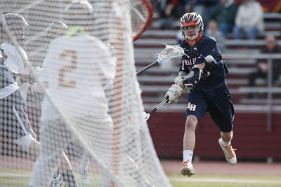 Lyman Hall's Matt Pettit gets a shot on goal Monday at Sheehan High School in Wallingford April 9, 2018 | Justin Weekes / Special to the Record-Journal