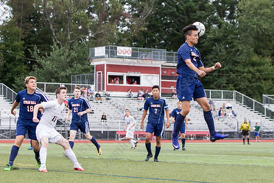 Lyman Hall's Sebastian Gonzalez heads a Cheshire throw in out of the defensive end Wednesday at Alumni Field in Cheshire. The match ended in a tie 1 to 1. September 20, 2017 | Justin Weekes / For the Record-Journal