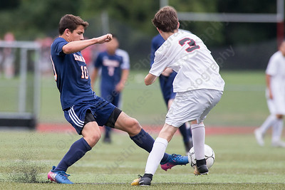 Lyman Hall's Tyler Stowik challenges Cheshire's Kyle Kuhlthau Wednesday at Alumni Field in Cheshire. The match ended in a tie 1 to 1. September 20, 2017 | Justin Weekes / For the Record-Journal