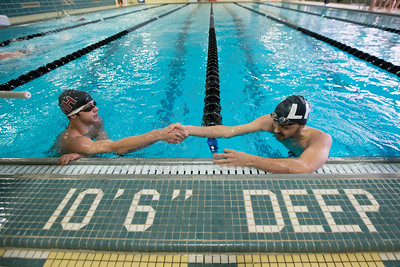 Lyman Hall's Nick Motmans congratulates North Haven's Will McCleary after the 200 freestyle Tuesday at Sheehan High School Natatorium in Wallingford  January 23, 2018 | Justin Weekes / Special to the Record-Journal