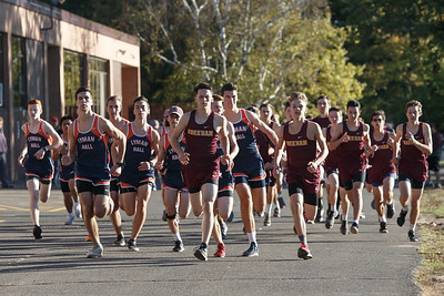 Runners in the boys race leave from the start Friday at Sheehan High School in Wallingford October 12, 2018 | Justin Weekes / Special to the Record-Journal