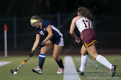 Lyman Hall's Kate Wallace works past Sheehan's Stephanie Phoenix Wednesday at Riccitelli Field on the campus of Sheehan High School in Wallingford October 4, 2017 | Justin Weekes / For the Record-Journal