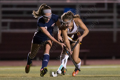 Sheehan's Allison Villano gets challenged by Riley Keating Wednesday at Riccitelli Field on the campus of Sheehan High School in Wallingford October 4, 2017 | Justin Weekes / For the Record-Journal