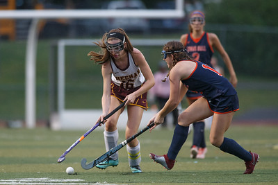 Sheehan's Kyra Connolly works past Lyman Hall's Avery McGovern Monday at Riccitelli Field on the campus of Sheehan High School in Wallingford September 17, 2018   Justin Weekes / Special to the Record-Journal
