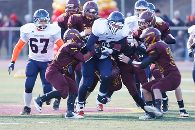 Lyman Hall's Justin Brown (40) barrels through Sheehan's defensive line during the Carini Bowl Thursday at Riccitelli Field in Wallingford November,28 2013 | Justin Weekes / For the Record-Journal