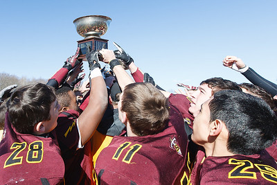 Sheehan football team raises the Carini Bowl trophy defeating Lyman Hall Thursday at Riccitelli Field in Wallingford November,28 2013 | Justin Weekes / For the Record-Journal