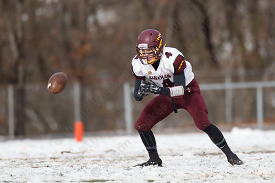 Sheehan's Bobby Carey (4) fields a punt from Lyman Hall on a bounce Thursday during the Carini Bowl at Fitzgerald Field in Wallingford Nov 27, 2014 | Justin Weekes / For the Record-Journal
