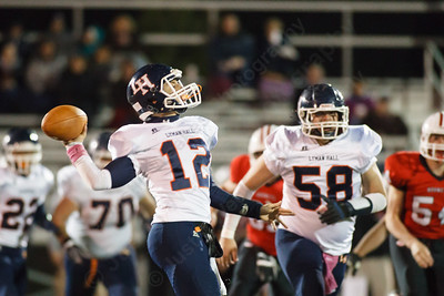 Lyman Hall's Stephen Grammatico (12) drops back for a pass Thursday at Branford High School in Branford  October,30 2014   Justin Weekes / For the Record-Journal