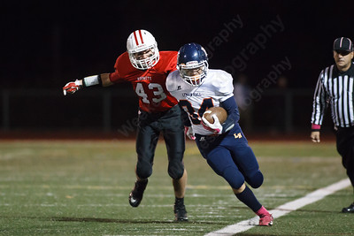 Lyman Hall's Anthony Esposito (34) gets forced out of bounds by Branford's James Dering (43) Thursday at Branford High School in Branford  October,30 2014   Justin Weekes / For the Record-Journal