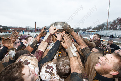 Sheehan players reach to touch the Carini Bowl after beating Lyman Hall Thursday during the Carini Bowl at Fitzgerald Field in Wallingford Nov 27, 2014 | Justin Weekes / For the Record-Journal