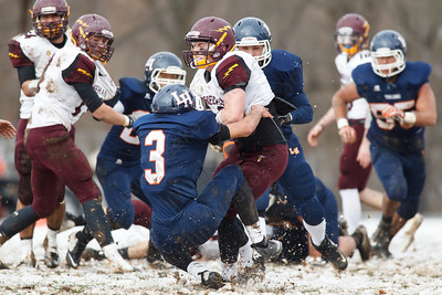 Sheehan's Kevin Friscol (1) runs through Lyman Hall's Christian Perez-Cameron (3) Thursday during the Carini Bowl at Fitzgerald Field in Wallingford Nov 27, 2014 | Justin Weekes / For the Record-Journal