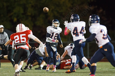 Lyman Hall's Stephen Grammatico (12) hits Nick Vendetto (44) for a gain Thursday at Branford High School in Branford  October,30 2014   Justin Weekes / For the Record-Journal