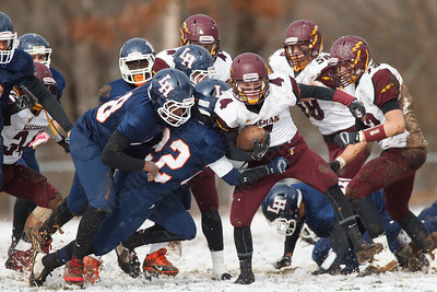 Sheehan's Bobby Carey (4) gets in some open space as Lyman Hall James Burnham (22) tries to tackle  Thursday during the Carini Bowl at Fitzgerald Field in Wallingford Nov 27, 2014 | Justin Weekes / For the Record-Journal