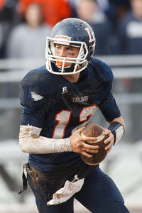 Lyman Hall Stephen Grammatico (12) rolls out to pass Thursday during the Carini Bowl at Fitzgerald Field in Wallingford Nov 27, 2014 | Justin Weekes / For the Record-Journal