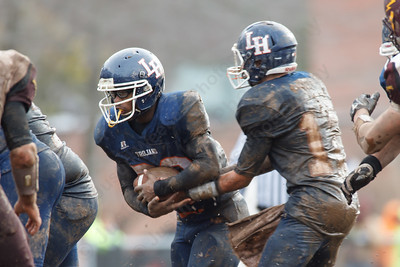 Lyman Hall's Stephen Grammatico (12) hands off to Brandon Forbes (20) Thursday during the Carini Bowl at Fitzgerald Field in Wallingford Nov 27, 2014 | Justin Weekes / For the Record-Journal