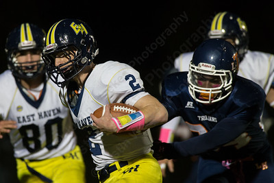 Lyman Hall's Anthony Esposito (34) reaches for East Haven's running back Austin Thornberg (2) Thursday at Riccitelli Field in Wallingford Oct. 15, 2015 | Justin Weekes / For the Record-Journal