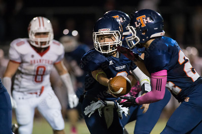 Lyman Hall's Connor O'Malley (2) hands off to Nick Santello (24) Thursday at Riccitelli Field in Wallingford Oct. 22, 2015   Justin Weekes / For the Record-Journal