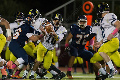 East Haven's quarterback Trevor Angelo (10) pitchs to running back Austin Thornberg (2) Thursday at Riccitelli Field in Wallingford Oct. 15, 2015 | Justin Weekes / For the Record-Journal