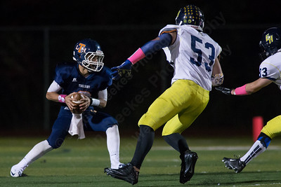 Lyman Hall's Connor O'Malley (2) gets pressure from East Haven's defense Thursday at Riccitelli Field in Wallingford Oct. 15, 2015 | Justin Weekes / For the Record-Journal