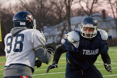 Lyman Hall's Colton Brown works the corner on Tim Hetrich Monday during practice at Fitzgerald Field in Wallingford Nov. 23, 2015 | Justin Weekes / For the Record-Journal