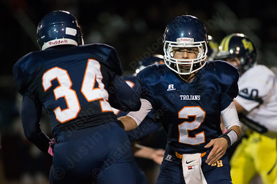 Lyman Hall's Connor O'Malley (2) hands off to Anthony Esposito (34) Thursday at Riccitelli Field in Wallingford Oct. 15, 2015 | Justin Weekes / For the Record-Journal