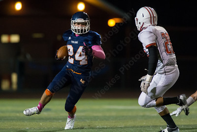 Lyman Hall's Nick Santello (24) looks for running room on the right side with Branford's Noah DeGoursey (26) defending Thursday at Riccitelli Field in Wallingford Oct. 22, 2015 | Justin Weekes / For the Record-Journal