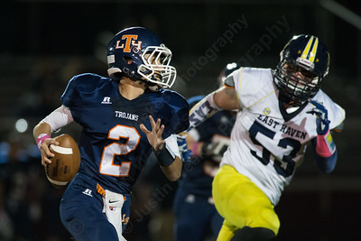 Lyman Hall's Connor O'Malley (2) rolls out right looking for a receiver late in the second quarter with East Haven Thursday at Riccitelli Field in Wallingford Oct. 15, 2015 | Justin Weekes / For the Record-Journal
