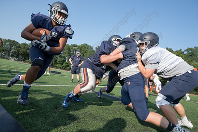 Lyman Hall's Austin Ruiz carries the ball in an offensive drill Thursday at Lyman Hall High School in Wallingford  Aug. 24, 2017 | Justin Weekes / For the Record-Journal