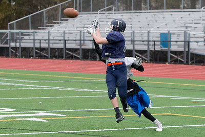 Lyman Hall's John Forster catches a pass guarded by Amiri Vaughn  Tuesday as the Trojans prepare for the Carini Bowl at Lyman Hall High School in Wallingford November 14, 2017 | Justin Weekes / For the Record-Journal