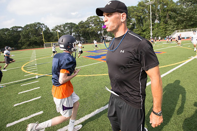 Lyman Hall's new head coach Bill Weyrauch runs drills during practice Tuesday at Lyman Hall High School in Wallingford Aug. 22, 2017 | Justin Weekes / For the Record-Journal