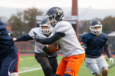 Lyman Hall's Randy McFarline run a play Tuesday as the Trojans prepare for the Carini Bowl at Lyman Hall High School in Wallingford November 14, 2017 | Justin Weekes / For the Record-Journal