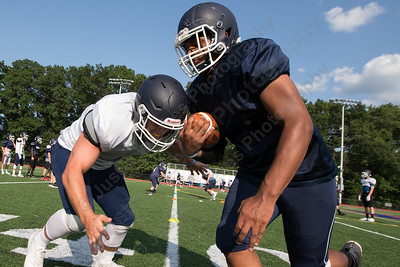 .lh Nick Santillo tries to tackle Qristopher Johnson Thursday at Lyman Hall High School in Wallingford  Aug. 24, 2017 | Justin Weekes / For the Record-Journal