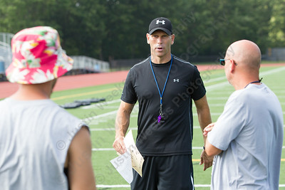 Lyman Hall's new head coach Bill Weyrauch talks with his coaching staff Tuesday at Lyman Hall High School in Wallingford Aug. 22, 2017 | Justin Weekes / For the Record-Journal