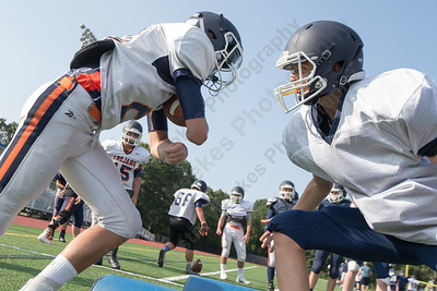 Lyman Hall's Alex Riccitelli left is blocked by Alex Colavito during practice Thursday at Lyman Hall High School in Wallingford  Aug. 24, 2017 | Justin Weekes / For the Record-Journal