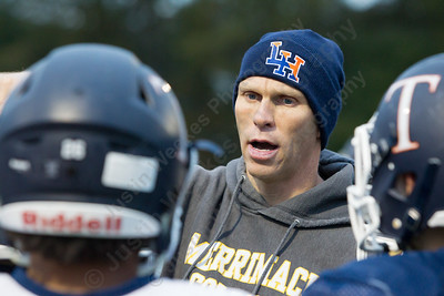 Lyman Hall's head coach Bill Weyrauch talks with players Tuesday as the Trojans prepare for the Carini Bowl at Lyman Hall High School in Wallingford November 14, 2017 | Justin Weekes / For the Record-Journal