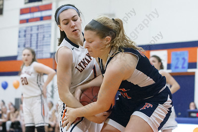 Lyman Hall's Julia Capello wrestles for a rebound with Foran's Emma Lucas  Friday at Lyman Hall High School in Wallingford February 9, 2018 | Justin Weekes / Special to the Record-Journal