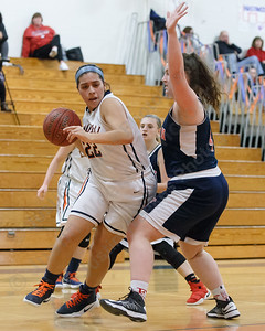 Lyman Hall's Kelly Fernandez droves past Foran's Jade Lord Friday at Lyman Hall High School in Wallingford February 9, 2018 | Justin Weekes / Special to the Record-Journal