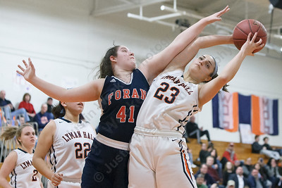 Lyman Hall's Sam Carbone pulls down an offensive rebound from Foran's Jade Lord Friday at Lyman Hall High School in Wallingford February 9, 2018 | Justin Weekes / Special to the Record-Journal