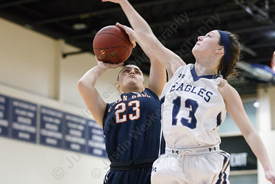 Lyman Hall's Sam Carbone puts in a layup as Wethersfield's Isabella Samse tries to block Tuesday during the CIAC Class L first round at Wethersfield High School in Wethersfield February 27, 2018 | Justin Weekes / Special to the Record-Journal