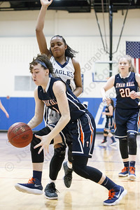 Lyman Hall's Julia Capello wins a loose ball Tuesday during the CIAC Class L first round at Wethersfield High School in Wethersfield February 27, 2018 | Justin Weekes / Special to the Record-Journal