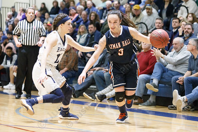 Lyman Hall's Kailey Lipka drives past Wethersfield's Isabella Samse Tuesday during the CIAC Class L first round at Wethersfield High School in Wethersfield February 27, 2018 | Justin Weekes / Special to the Record-Journal