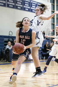 Lyman Hall's Elise Hastings drives past Wethersfield's Gabriella Amoddio Tuesday during the CIAC Class L first round at Wethersfield High School in Wethersfield February 27, 2018 | Justin Weekes / Special to the Record-Journal