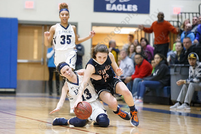 Lyman Hall's Elise Hastings dives after a loose ball with Wethersfield's Isabella Samse Tuesday during the CIAC Class L first round at Wethersfield High School in Wethersfield February 27, 2018 | Justin Weekes / Special to the Record-Journal