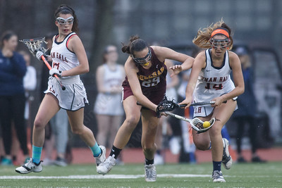 Sheehan's Carlee Crispens picks up a loose ball Friday at Lyman Hall High School in Wallingford April 27, 2018 | Justin Weekes / Special to the Record-Journal