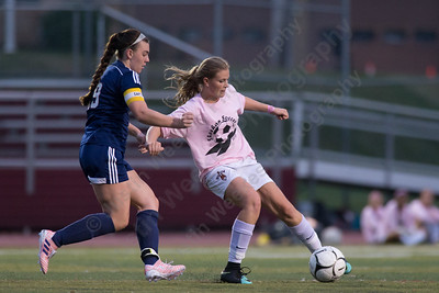 Sheehan's Kelsey Burr cuts to beat Lyman Hall's Demiree Cyr Wednesday at Riccitelli Field in Wallingford October 25, 2017 | Justin Weekes / For the Record-Journal